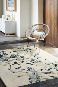grey rug with a floral pattern